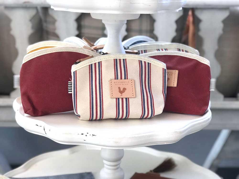 selection of brand meanwhile purses and cosmetic bags in burgundy and stripes