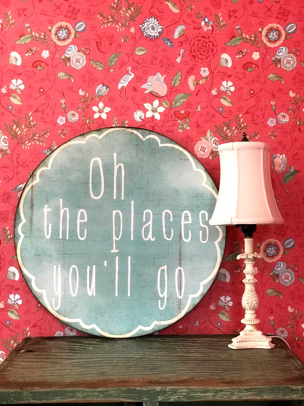 Sign that reads: oh the places you'll go next to decorative lamp